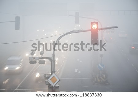 Road intersection in thick fog - blurred motion