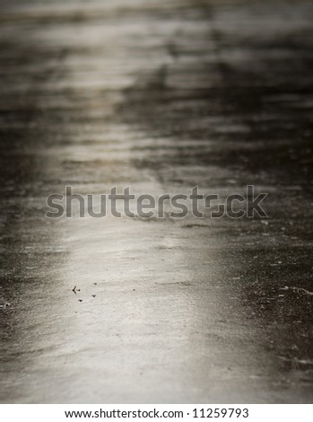 Road just after the rain. Lights reflexions in the wet surface. Focus on firs plan. - stock photo