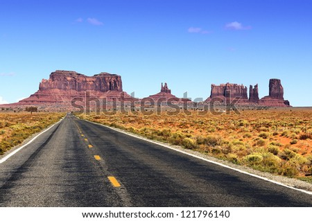 Road leading into Monument Valley. - Shutterstock ID 121796140