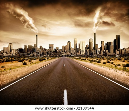 Road leading to a polluted city - stock photo