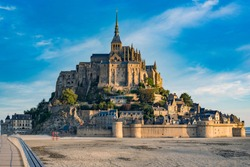 Road leading to Mont Saint Michael with its abbey and low tide