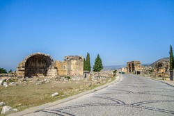 Road leading to north necropolis of antique city Hierapolis, Pamukkale, Turkey. There are remains of family crypts (left side) & basilica with baths (right side). All city included in UNESCO List