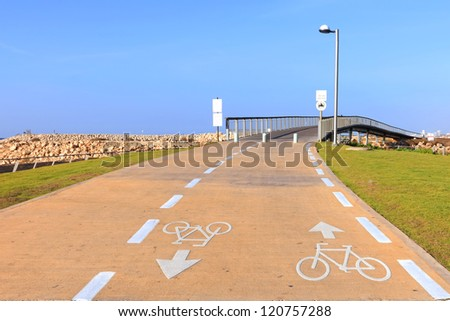 Road marking of the bicycle path on Tel Aviv New promenade - popular recreational area of Tel Aviv city. Mediterranean, Israel