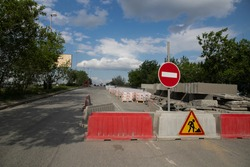 Road marking on the road, warning signs. Direction of detour, sign speed limit 40 and roadworks. Road signs denoting road repairs, speed limit up to 40, detour