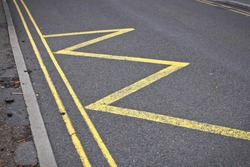 Road markings indicating no stopping or parking