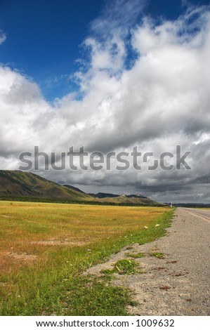 Road, mountains and skies