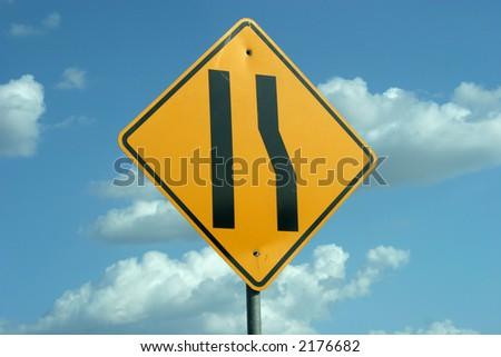 Road narrows sign