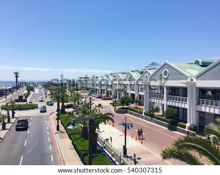 Road near rock beach with blue sky in Victoria & Alfred Waterfront, Cape Town, South Africa. #540307315
