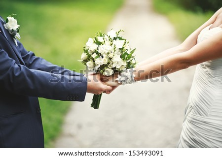 road of love and happiness, hands of a newly wed couple together #153493091
