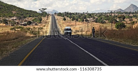 road  of malawi with people and cars