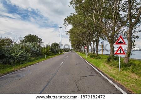 Road on a narrow strech of land on the port area of Rotterdam, Landtong near Rozenburg Stockfoto ©