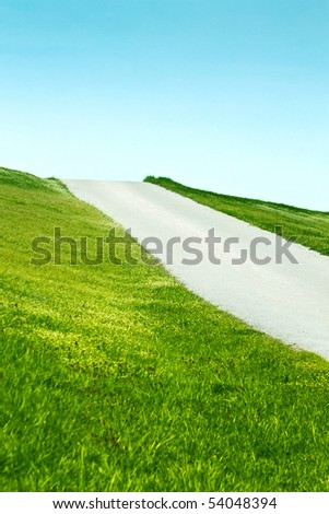 Road on a sunny hill