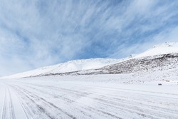 road on snow area plateau, snow covered the national highway in Tibet, China