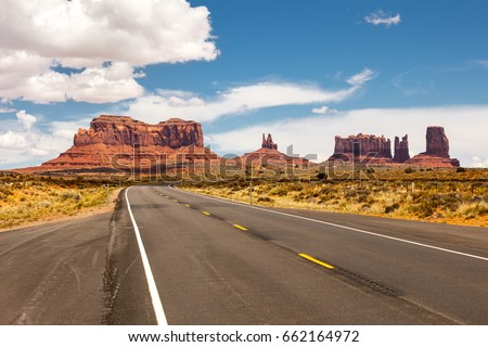 Road passing through Monument Valley, beautiful sunny day with blue sky in summer, Utah, USA - Shutterstock ID 662164972