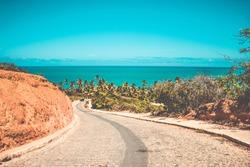 Road path leading to Coqueirinho's beach with the ocean view in Conde, Paraiba, Brazil