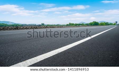 Road Pavement and Natural Landscape of Landscape #1411896953