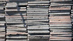 Road paving tiles stacked on top of each other in a sunny day