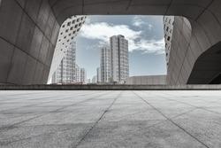Road platform under modern city architecture