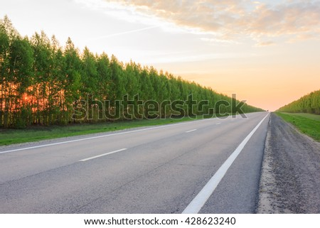 road receding into the distance, becomes a point on the horizon