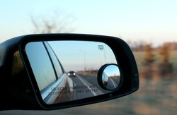 Road reflecting in mirrors