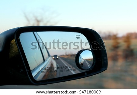 Road reflecting in mirrors #547180009