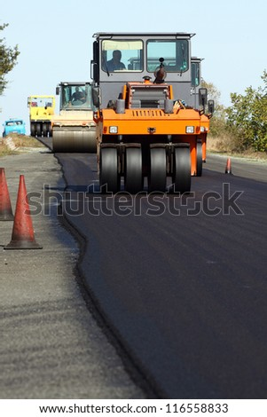 Road roller in work on the road