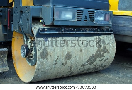 road roller parked in a factory