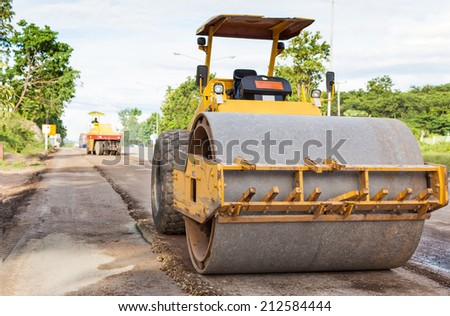 Road rollers during asphalt compaction works