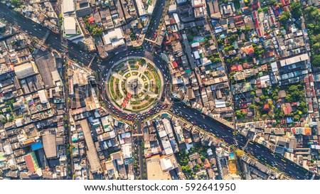 Road roundabout with car lots Wongwian Yai in Bangkok,Thailand. street large beautiful downtown at evening light.  Aerial view , Top view ,cityscape ,Rush hour traffic jam #592641950