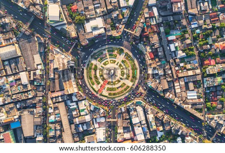 Road roundabout with car lots Wongwian Yai in Bangkok,Thailand. street large beautiful downtown at evening light.  Aerial view , Top view ,cityscape ,Rush hour traffic jam #606288350