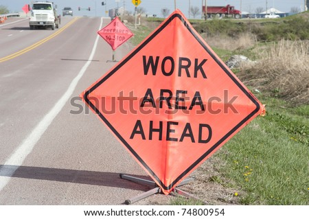 Road-side signs warning motorists of work ahead