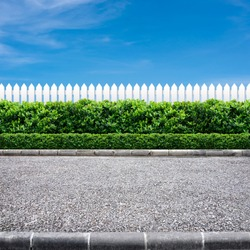 Road side view and white fence on blue sky