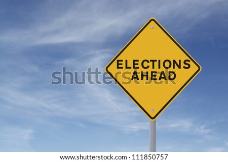 Road sign announcing elections ahead (against a blue sky background)