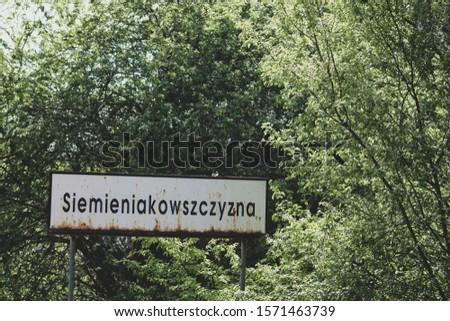 Road sign in Siemieniakowszczyzna village (Siemieniakowszczyzna word on the sign is the name of the village) Zdjęcia stock ©