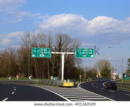 Road Sign in the motorway junction in Northen Italy with crossroad to go to Austria or Slovenia #401360509
