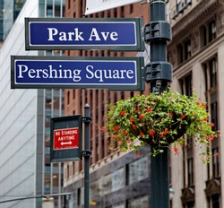 Road sign in the street. Park Ave. Pershing Square. New York. United States.