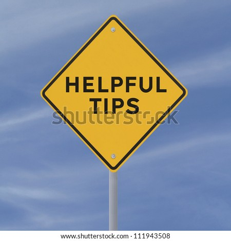 Road sign indicating Helpful Tips (against a blue sky background)