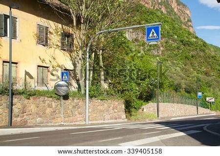 Road sign pedestrian crossing point on a dangerous street