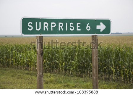 Road sign pointing to Surprise, Nebraska