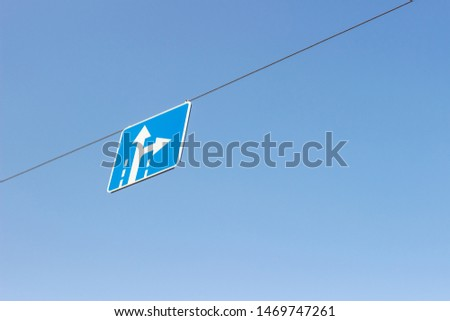 road sign right and right against a blue sky #1469747261