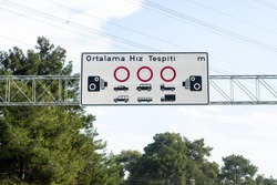 Road sign showing average speed determination in Turkey.  Translate  (Turkısh = Ortalama Hız Tespiti - English = Average speed detection)