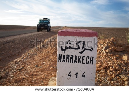 Road Sign to Marrakech in Morocco with blue sky