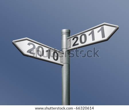 road sign two arrows indicating to past and future 2010 and 2011 old to new year