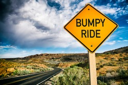 Road sign warning about a Bumpy Ride ahead on deserted scenic summer desert highway