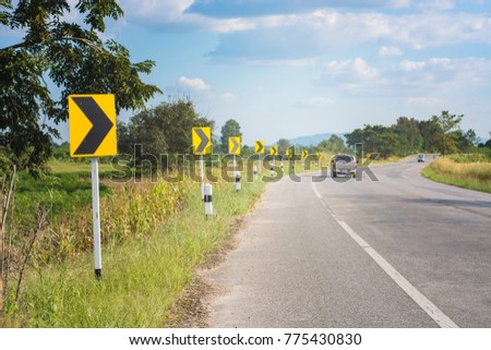 Road sign warning sign for turn right with a car. #775430830