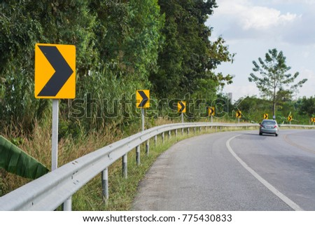 Road sign warning sign for turn right with a car. #775430833