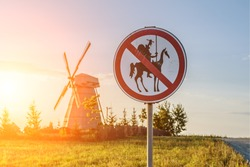 Road sign, which prohibits Don Quixote approach to the mill.