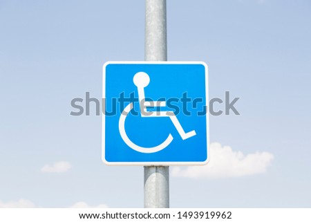 Road sign with blue sky: space reserved for people with reduced mobility. Spain.