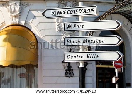 road signpost in nice france against fancy hotel facade