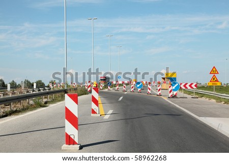 Road signs in a highway on reconstruction
